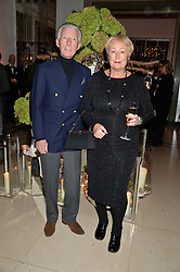 British Savile Row tailor and fashion designer EDWARD SEXTON and his wife JOAN at a reception hosted by Wei Koh founder of The Rake Magazine and Thomas Kochs General Manager of Claridge's to celebrate London Collections: Man 2014 at Claridge's, Brook Street, London on 5th January 2014.