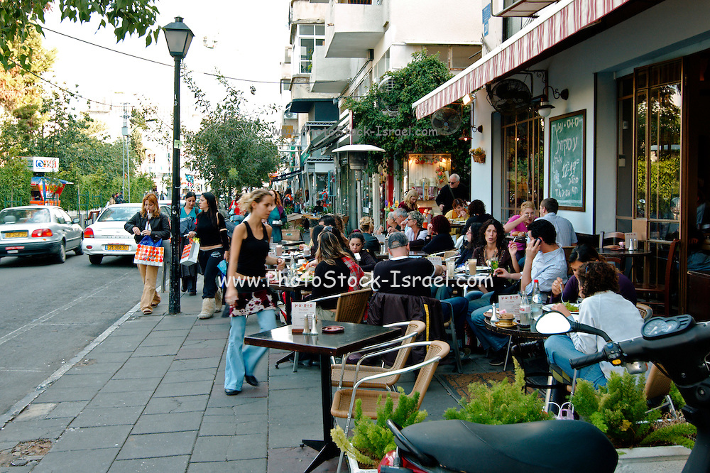 Israel Tel Aviv Drinking Coffee and relaxing in an open air cafe in Shenkin Street November 2005