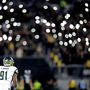 South Florida Bulls defensive end Frank Johnson (91) is seen on a kickoff as UCF fans turn on their cell phone lights during a NCAA football game between the University of South Florida Bulls and the UCF Knights at Spectrum Stadium on Friday, November 24, 2017 in Orlando, Florida. (Alex Menendez via AP)