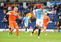 Blackburn Rovers' Jordan Rhodes gets a shot away as he is closed down by Blackpool's Jamie O'Hara<br /> <br /> Photographer Andrew Vaughan/CameraSport<br /> <br /> Football - The Football League Sky Bet Championship - Blackburn Rovers v Blackpool - Saturday 21st February 2015 - Ewood Park - Blackburn<br /> <br /> © CameraSport - 43 Linden Ave. Countesthorpe. Leicester. England. LE8 5PG - Tel: +44 (0) 116 277 4147 - admin@camerasport.com - www.camerasport.com