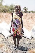 Mcc0075406 . Daily Telegraph<br /> <br /> DT Foreign<br /> <br /> Elizabeth Nyatour, 35 has five children to feed and has been surviving on eating water lillies .<br /> <br /> Women and children walked for hours today to UN food air drop in Padeah , in a famine hit area of war torn Unity State . <br /> <br /> <br /> Padeah 1 March 2017