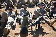 Marines sit around their packs and weapons, including an AT-4 rocket, while waiting for the days' live-fire exercise to begin at Camp Pendleton last weekend.