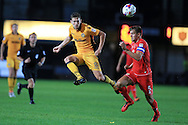 Mark Randall of Newport county (l) is challenged by Scott Wooton of MK Dons ®. EFL cup, 1st round match, Newport county v Milton Keynes Dons at Rodney Parade in Newport, South Wales on Tuesday 9th August 2016.<br /> pic by Andrew Orchard, Andrew Orchard sports photography.