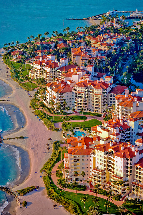 Aerial view of luxury condos, beach and yacht marina at Florida's Fisher Island near Miami