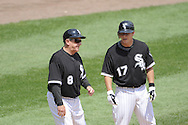 CHICAGO - JUNE 08:  Third base coach Jeff Cox #8 talks things over with Chris Getz #17 of the Chicago White Sox during the game against the Detroit Tigers on June 8, 2009 at U.S. Cellular Field in Chicago, Illinois.  The Tigers defeated the White Sox 5-4.  (Photo by Ron Vesely)