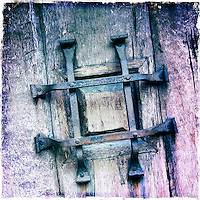 25 February 2012:  Metal Iron door detail at winery.  iPhone Stock Photo