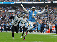 American Football - 2018 NFL Season (NFL International Series, London Games) - Tennessee Titans vs. Los Angeles Chargers<br /> <br /> Tyrell Williams of the Los Angeles Chargers runs clear to score his touchdown with Kevin Byard and Logan Ryan unable to catch him, at Wembley Stadium.<br /> <br /> COLORSPORT/ANDREW COWIE