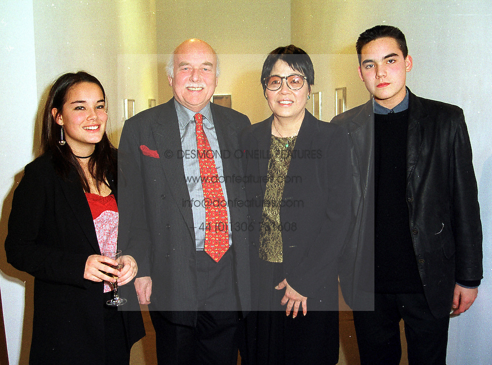 Left to right, the HON.BROOKE MacKAY, his parents LORD & LADY TANLAW and their daughter the HON.ASIA MacKAY at an exhibition in London on 16th December 1999.MZY 1
