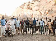 Nuba tribesman before they participate in a village wrestling match. Nuba tribesmen wrestle for sport and as a show of strength. Often different tribes would wrestle each other in friendly competition. Nyaro village, Kordofan region, Sudan
