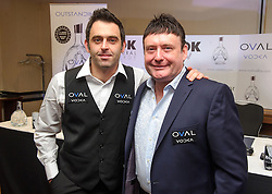 © Licensed to London News Pictures. 26/02/2013 London, UK. Reigning world snooker champion Ronnie O'Sullivan (left) announces his return to snooker with Jimmy White at The London Hilton Metropole Hotel. The 37 year old pulled out of the 2012-13 season due to 'personal reasons' after playing just one match. He plans to defend his title with his first match at The Crucible, Sheffield in April this year..Photo credit : Simon Jacobs/LNP