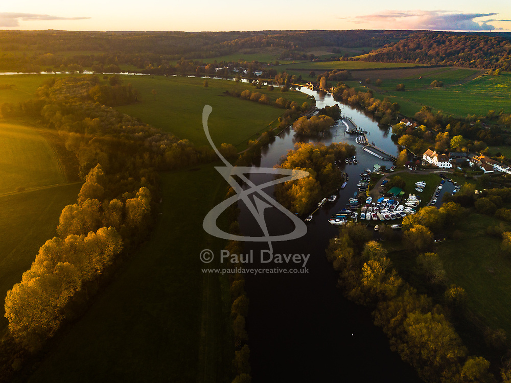 The sun sets over the autumnal landscape on a chilly autumn afternoon near Henley on Thames. Henley On Thames, Oxfordshire, October 29 2018.