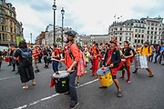 Drummers crew are seen drumming from Trafalgar Square towards a busy Junction near Covent Garden during an Extinction Rebellion climate protest in central London on Monday, Aug 23, 2021. Protestors are demanding that Government halt all new investment in fossil fuels. (VX Photo/ Vudi Xhymshiti)