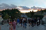 sunset seen from top of stairs at the Tsurugaoka Hachiman-gu Shinto shrine in Kamakura Japan