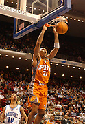 December 8, 2003, Orlando, Florida, USA;  Shawn Marion of the Phoenix Suns dunks against the Orlando Magic for two of his 29 points as the Suns lose to the Magic 105-98.