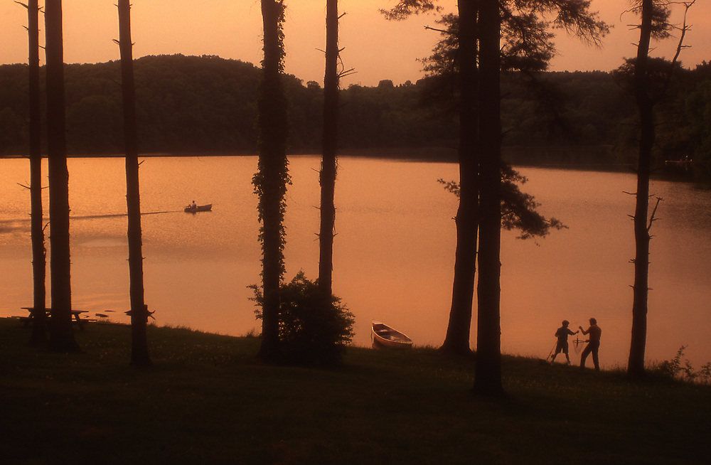 PA landscapes, York County park lake, father and son catch fish
