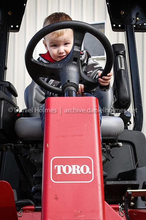(5/31/14, FRANKLIN, MA) Colin Bingham, 2, of Bellingham, pretends to drive a lawn mower during the annual Touch-A-Truck event at the Franklin DPW on Saturday. Daily News and Wicked Local Photo/Dan Holmes