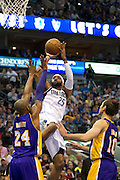 Vince Carter (25) of the Dallas Mavericks shoots the ball over Kobe Bryant (24) of the Los Angeles Lakers at the American Airlines Center in Dallas on Sunday, February 24, 2013. (Cooper Neill/The Dallas Morning News)