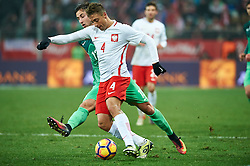 Wroclaw, Poland - 2016 November 14: Thiago Cionek of Poland fights for the ball with Andraz Sporar of Slovenia during Poland v Slovenia - International Friendly Soccer Match at Municipal Stadium on November 14, 2016 in Wroclaw, Poland.<br /> <br /> Adam Nurkiewicz declares that he has no rights to the image of people at the photographs of his authorship.<br /> <br /> Picture also available in RAW (NEF) or TIFF format on special request.<br /> <br /> Any editorial, commercial or promotional use requires written permission from the author of image.<br /> <br /> Mandatory credit:<br /> Photo by © Adam Nurkiewicz / Mediasport