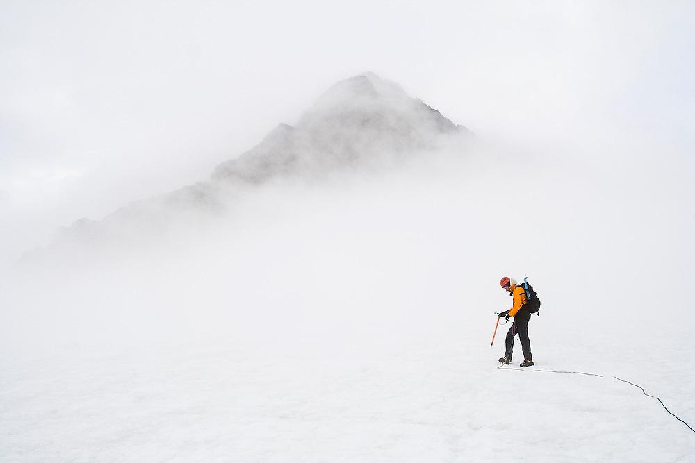 Yoav Bar-Ness leads a climbing team across the Sulphide Glacier towards the summit pyramid of Mount Shuksan, North Cascades National Park, Washington.
