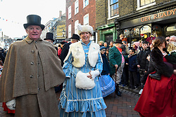 © Licensed to London News Pictures. 08/12/2019. ROCHESTER, UK.  Participants take part in the annual Dickensian Christmas Festival in Rochester.  The Kent town is given a Victorian makeover to celebrate the life of the writer Charles Dickens (who spent much of his life there), with Victorian themed street entertainment, costumed parades and a Christmas market.  Photo credit: Stephen Chung/LNP