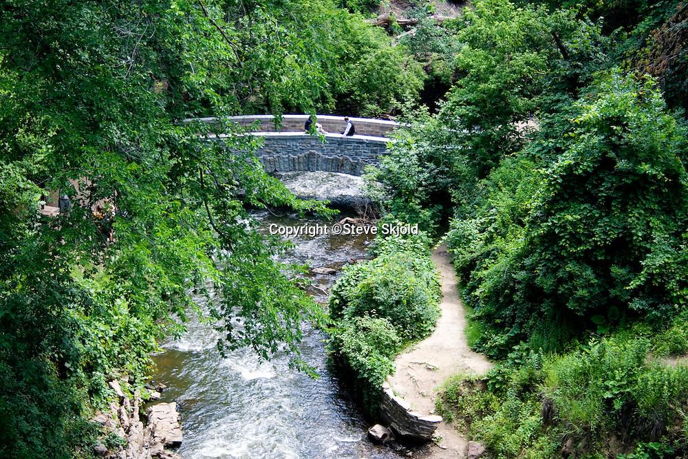 Bridge over Minnehaha creek near the falls. Svenskarnas Dag Swedish Heritage Day Minnehaha Park Minneapolis Minnesota USA
