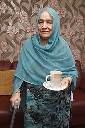 Elderly South Asian lady.