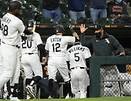 CHICAGO - APRIL 12:  Adam Eaton #12 in greeted by Bench Coach Miguel Cairo #41 of the Chicago White Sox after Eaton hit a three run home run in the third inning against the Cleveland Indians on April 12, 2021 at Guaranteed Rate Field in Chicago, Illinois.  (Photo by Ron Vesely) Subject:  Adam Eaton; Miguel Cairo