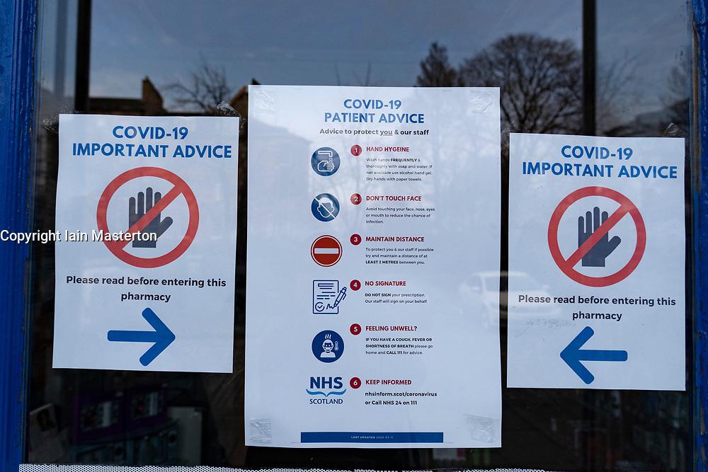 Edinburgh, Scotland, UK. 18 March 2020. Coronavirus warning and information  signs on door of pharmacy in Edinburgh,. Iain Masterton/Alamy Live News.