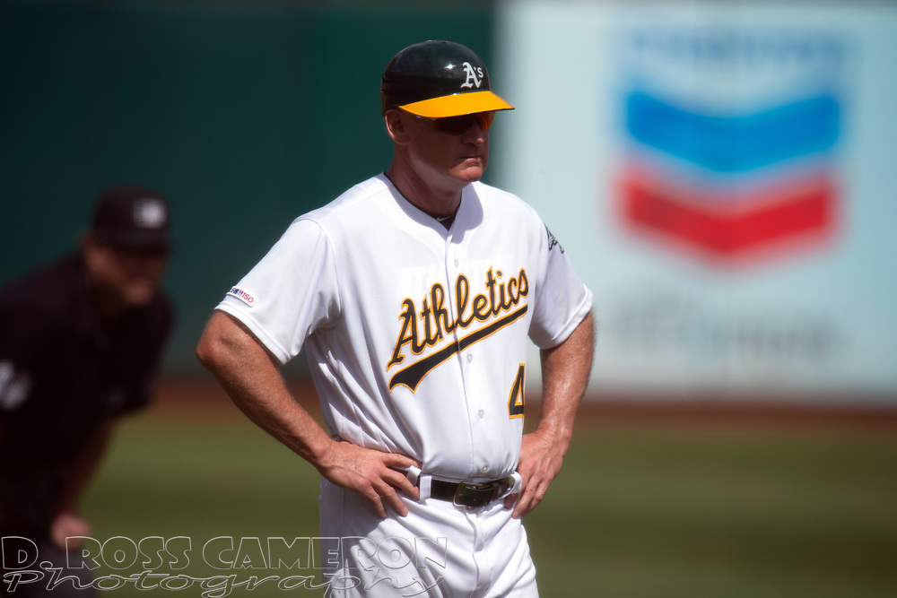 Oakland Athletics third base coach Matt Williams (4) stands on the field during the second inning of a baseball game against the Texas Rangers, Sunday, Sept. 22, 2019, in Oakland, Calif. (AP Photo/D. Ross Cameron)