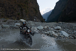 Trip co-leader Buddhi Singh navigates another water crossing on his Royal Enfield Himalayan on Motorcycle Sherpa's Ride to the Heavens motorcycle adventure in the Himalayas of Nepal. On the sixth day of riding, we went from Tatopani to Pokhara. Saturday, November 9, 2019. Photography ©2019 Michael Lichter.