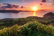The coast of Milos island at sunset