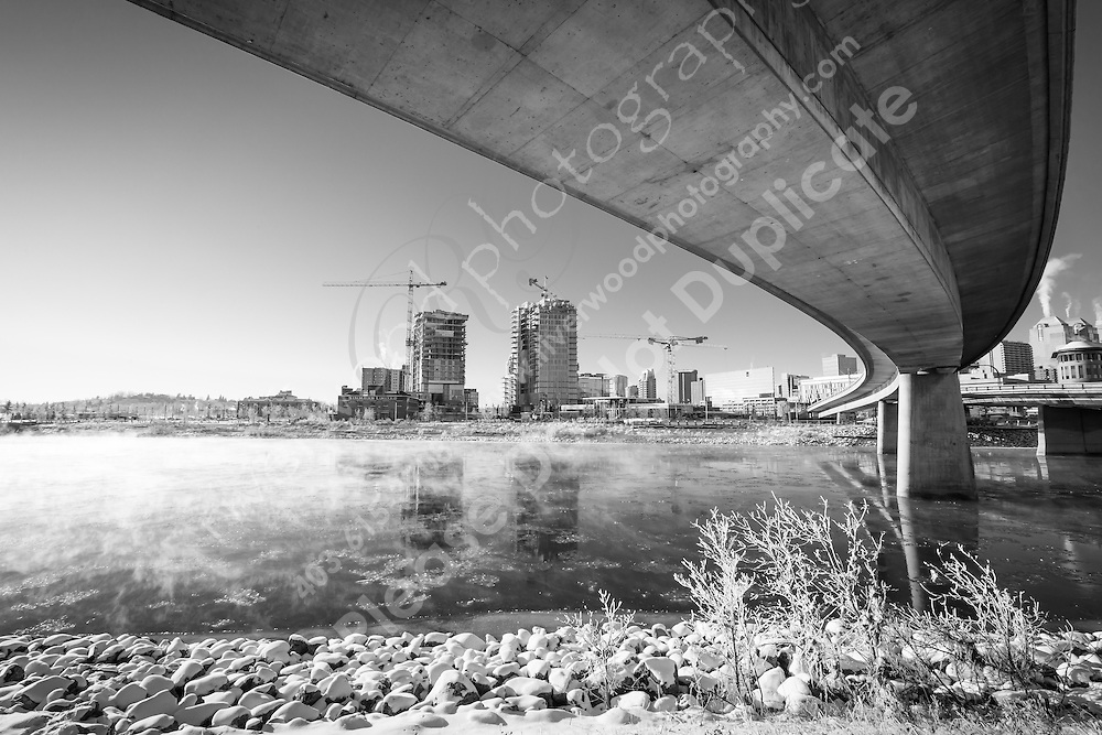 Downtown Calgary and the Bow River on a cold and sunny morning with ice fog lifting off the river.<br /> <br /> ©2014, Sean Phillips<br /> http://www.RiverwoodPhotography.com