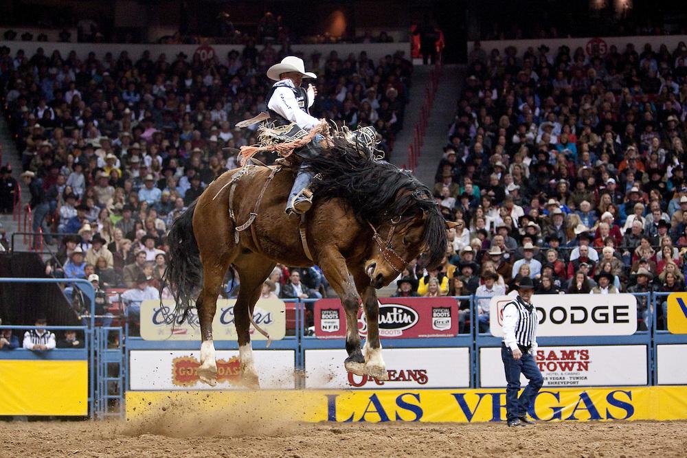 Bradley Harter, saddle bronc rider.2009 Wrangler National Finals Rodeo, round 10. Saturday, December 12, 2009. The Thomas & Mack Center, Las Vegas, Nevada. Photograph ©2009 Darren Carroll