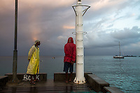 Anse La Raye, Saint Lucia: Fishermen wait on the weather before launching their boats shortly after dawn.