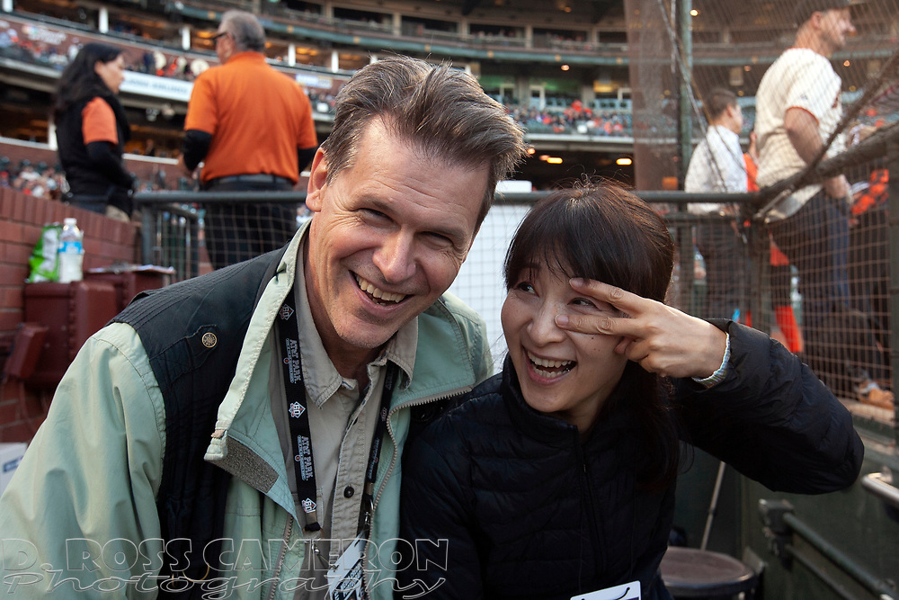 """D. Ross Cameron, left, and Miwako """"Mew"""" Mizumi pose for a photograph before a baseball game between the San Francisco Giants and New York Mets, Friday, Aug. 31, 2018, in San Francisco. (Photo by Stan Szeto/USA Today Sports Images)"""