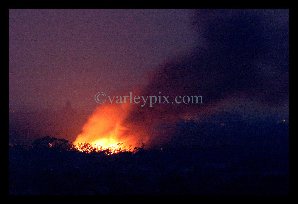 4th Sept, 2005. Hurricane Katrina aftermath. New Orleans, Louisiana. A fire rages out of control in Mid City, New Orleans.
