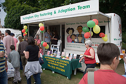 People passing the Nottingham City Fostering and Adoption Recruitment team's stand at Nottingham's 2005 Gay Pride Lesbian festival; held at the Arboretum,