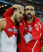 Lance Franklin and Adam Goodes of the Swans embrace after  the 2014 AFL Round 08 match between the Sydney Swans and the Hawthorn Hawks at ANZ Stadium, Sydney on May 09, 2014. (Photo: Craig Golding/AFL Media)