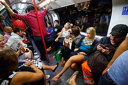© Licensed to London News Pictures. 20/08/2016. London, UK. Tube passengers travel on the night tube service of Central line in London for the first time on 20 August 2016. Transport for London started a 24-hour Tube service on Victoria and Central lines as demand has soared over recent years, with passenger numbers on Friday and Saturday nights up by around 70 per cent since 2000. The plan was announced in November 2013 and intended to begin in September 2015, but strikes over pay delayed the start by nearly another year. Photo credit: Tolga Akmen/LNP