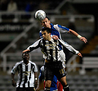 Photo: Jed Wee.<br /> Newcastle United v Portsmouth. Carling Cup. 25/10/2006.<br /> <br /> Portsmouth's Andy O'Brien (top) wins a ball from Newcastle's Giuseppe Rossi.