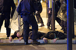 "© Licensed to London News Pictures . FILE PICTURE DATED 09/08/2011 .  Manchester , UK . DOMENYK NOONAN (pictured lying face down, first on the left, being detained by police during riots in Manchester City Centre on 9th August 2011) has been remanded in custody . He is accused of raping a 15 year old boy . He appeared at Manchester Crown Court via videolink from Manchester prison , charged with four counts of rape and false imprisonment . Police were called to a flat in Manchester City Centre on the afternoon of Wednesday (24th October). The organised crime boss and star of documentary ""At Home With the Noonans"" also goes under the name Lattlay-Fottfoy . He is a cousin of Mark Duggan , whose shooting sparked off riots in London in the summer of 2011 . Photo credit : Joel Goodman/LNP"
