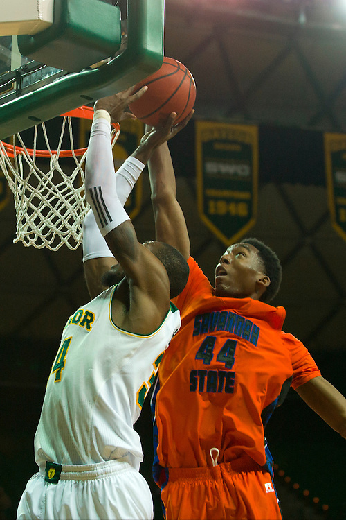 WACO, TX - JANUARY 3: Jyles Smith #44 of the Savannah State Tigers blocks the shot of Cory Jefferson #34 of the Baylor Bears on January 3, 2014 at the Ferrell Center in Waco, Texas.  (Photo by Cooper Neill) *** Local Caption *** Jyles Smith