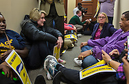 Protesters join a group from the NAACP who occupied Sessions' office in Mobile Alabama on Jan, 30, 2017.