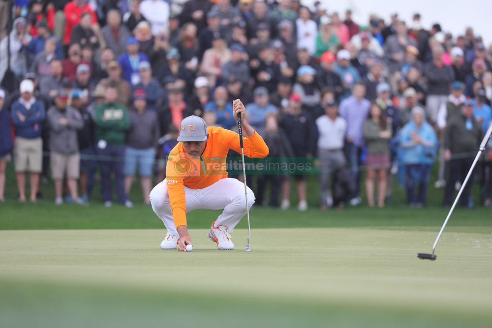 February 3, 2019 - Scottsdale, AZ, U.S. - SCOTTSDALE, AZ - FEBRUARY 03: Rickie Fowler places the ball in order to putt on the ninth hole during the final round of the Waste Management Phoenix Open on February 3, 2019, at TPC Scottsdale in Scottsdale, Arizona.  (Photo by Will Powers/Icon Sportswire) (Credit Image: © Will Powers/Icon SMI via ZUMA Press)