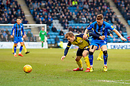Scunthorpe United forward George Thomas (18) and Gillingham FC midfielder Mark Byrne (33) during the EFL Sky Bet League 1 match between Gillingham and Scunthorpe United at the MEMS Priestfield Stadium, Gillingham, England on 16 February 2019.