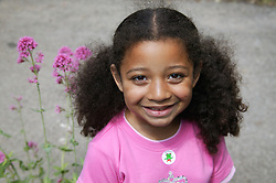Portrait of young girl with her hair in bunches,