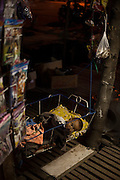 A baby sleeps in a crib ouside a shop in Mandalay, Burma.<br /> Note: These images are not distributed or sold in Portugal