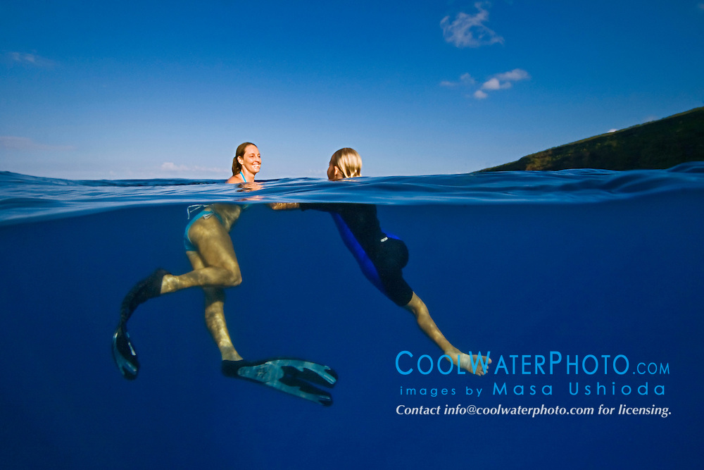 Mother and her daughter playing, Kealakekua Bay, Big Island, Hawaii, Pacific Ocean.
