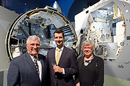 Garden City, New York, U.S. June 6, 2019. Apollo 17 astronaut HARRISON SCHMITT, at left, poses with two guests, at display of spacecraft interior at Cradle of Aviation, during Apollo at 50 Anniversary Dinner, an Apollo astronaut tribute celebrating the Apollo 11 mission Moon landing.