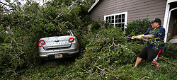 Resident Tim Harper clears brush to get to his car in the Dommerich Estates neighborhood in Maitland FL, USA on Monday, September 11, 2017, after Hurricane Irma passed through central Florida Sunday night. Photo by Joe Burbank/Orlando Sentinel/TNS/ABACAPRESS.COM
